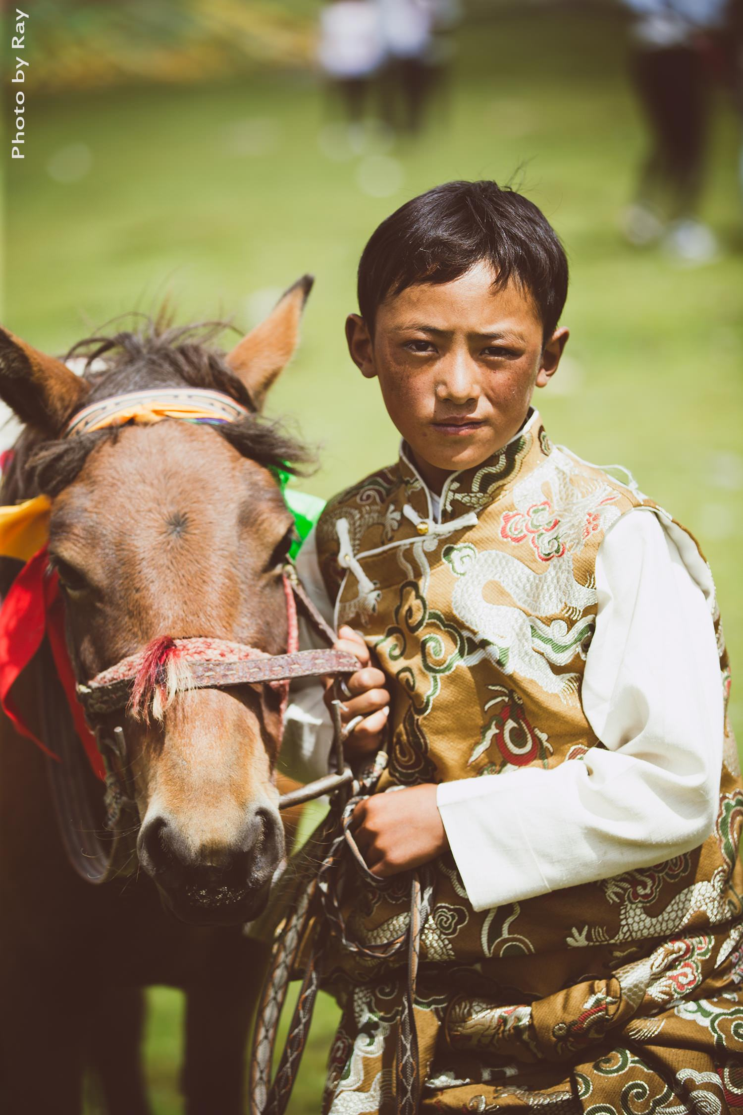 boy and horse in Tibet